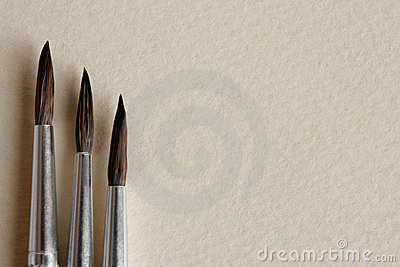 Paint brushes on papers background