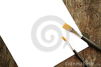Paint brushes and white paper