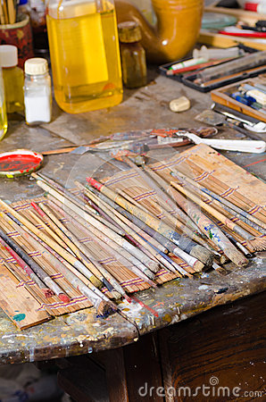 Paintbrushes in an atelier and oils