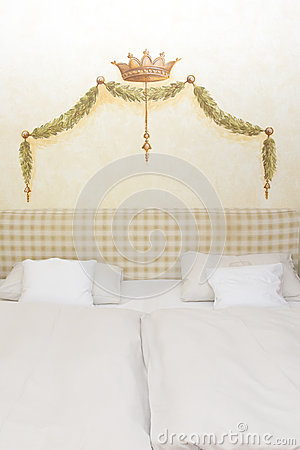 Painted crown and garland over bed