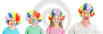 Painted faces clown wigs on family of dad and kids