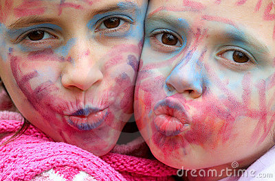 Painted faces kissing