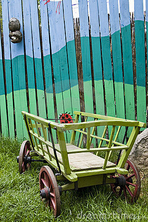Free Painted Fence With  Hay-waggon Stock Photos - 5390643