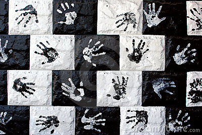 Painted wall with hand prints