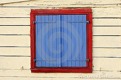 Painted window shutters on bea