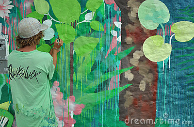 Painter painting a wall mural Editorial Image