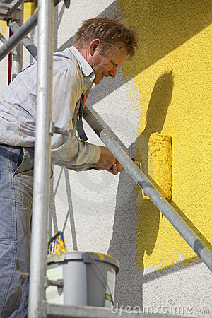 Painter with roller working