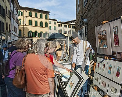 Painter selling art on the street Editorial Stock Image