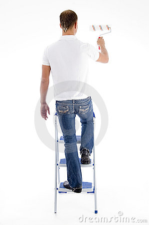 Painter standing on stairs