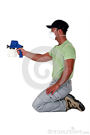Painter using a spray gun.
