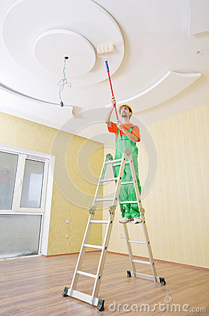 Painter worker during his job