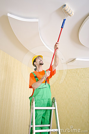 Painter worker during painting