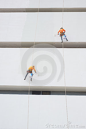 Free Painters High Building Condo Outdoors Sprinkle Stock Photography - 50365272