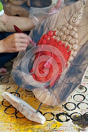 Painting a Buddha image