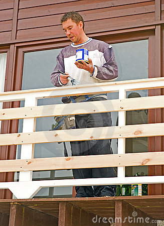 Painting new balcony on a modern house.