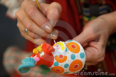 Painting pottery figurines. Russian folk craft.