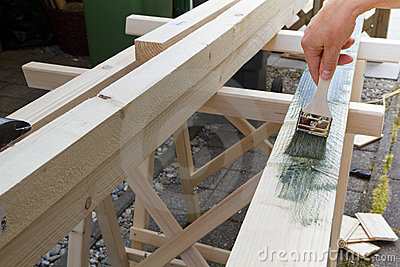 Painting a wooden beam