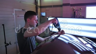 Paintless Dent Repair Removal. PDR. Man`s Hands Heat Up A Car With A  Special Tool In Order To Even Out A Dent Without Stock Video - Video of heat,  auto: 152840269