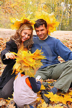 Free Pair And Child With Maple Leaves Royalty Free Stock Photography - 7095187