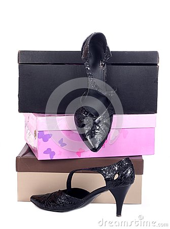 Pair of black winter women shoes and many boxes