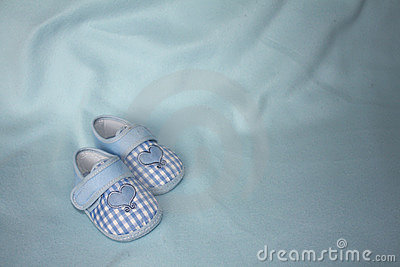A pair of blue checkered baby booties