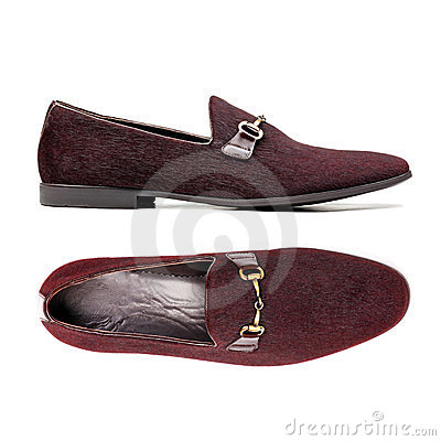 Pair of brown male shoes over white