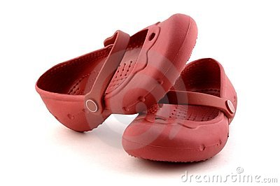 Pair of child red rubber shoes