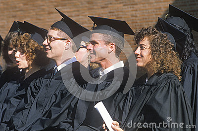 A pair of coeds watching their ceremony Editorial Stock Photo