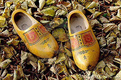 A pair of dutch wooden shoes in the autumn leaves