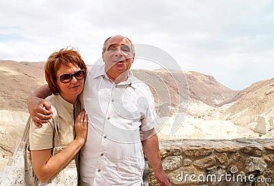Pair of elderly travelers