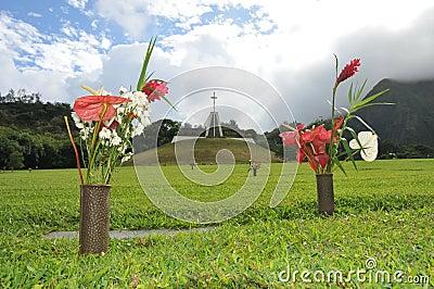 Pair of flower vases around a grave marker
