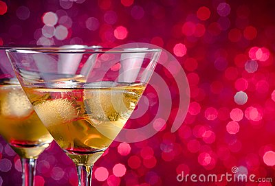 A pair of glasses of fresh cocktail with ice