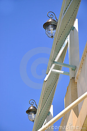 Pair of lamp on construction under blue sky