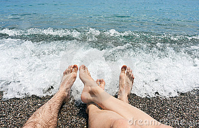 Pair legs on sea beach