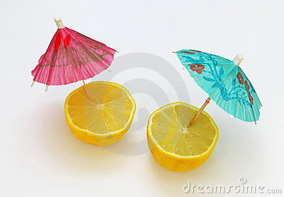 A pair of lemons with cocktail umbrellas