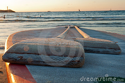 Pair of oars in front of the sea