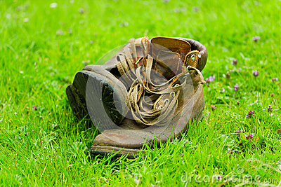 Pair of old boots on grass