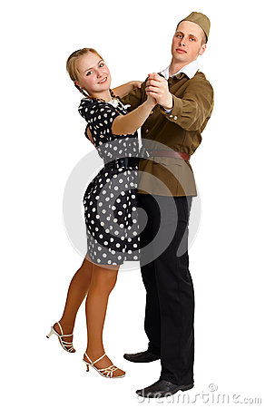 Pair in old-fashioned clothes dancing