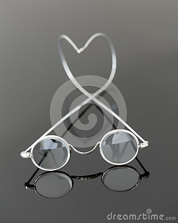 Pair of old magnifying reading glasses