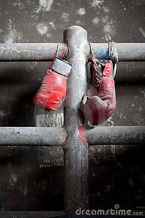 Pair of old and tattered boxing gloves