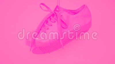 Pair of Pink Female Sneakers Hanging auf rosa Hintergrund Hell Rose Woman's Trainer Hang Out on the Rope Funky stile stock video