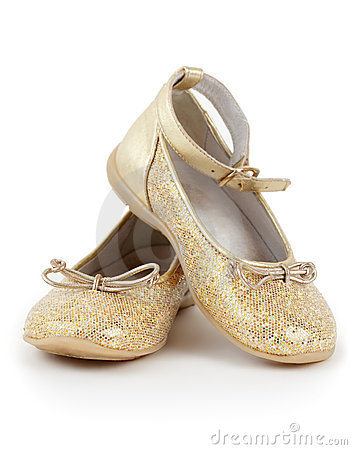 Pair of shiny golden shoes for girls