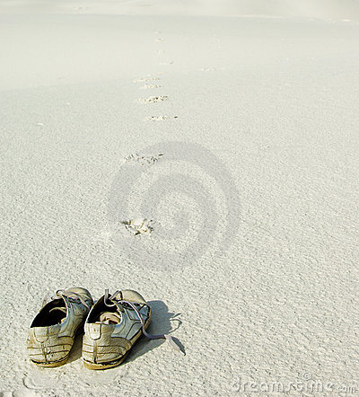 Pair of shoes on sand