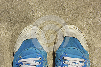 Pair of shoes on the sand Stock Photo