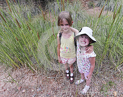 A Pair of Sisters Embrace Among the Cattails