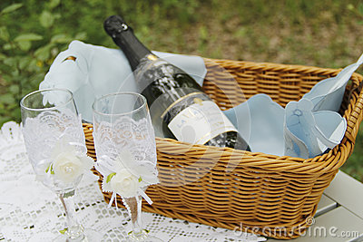 A pair of wedding glasses and basket
