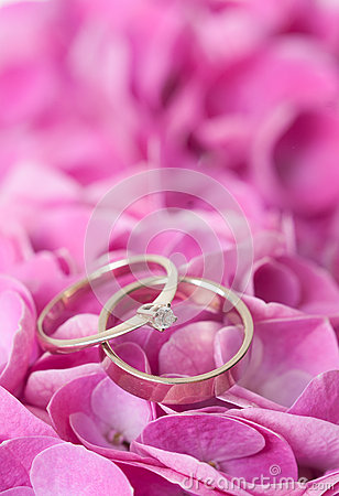 Pair of wedding rings on flowers