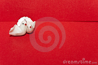 Pair of white doves on an envelope