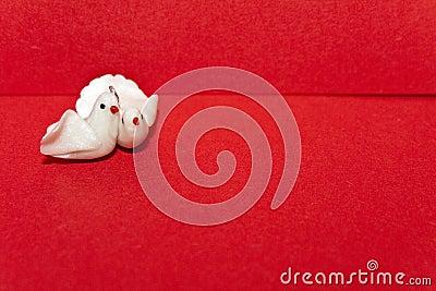 Pair of white doves on an envelope