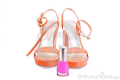 Pair of woman shoes with nail varnish